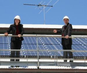 Murdoch University's Environmental Coordinator, Caroline Minton, with Vice Chancellor John Yovich, in front of the new solar panels